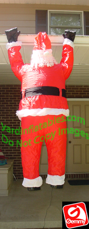 Santa Hanging From Gutter
