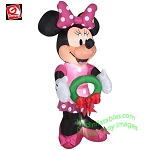 Minnie Bow-tique Holding Christmas Wreath