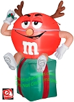 Red M&M Sitting on Present w/ Antlers