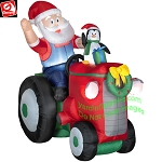 Santa On Tractor With Penguin Animated