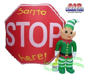 Elf Standing Next To Stop Sign