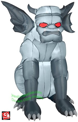 Grey Gargoyle Sitting With Red Eyes