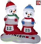 4' Airblown Inflatable Snowman In Stocking Race Scene